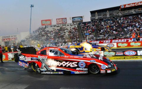 Courtney Force gets the early lead on Ron Capps in the NHRA Funny Car final on Sunday.