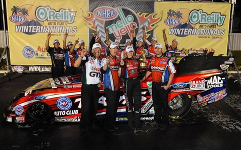Courtney Force and the John Force Racing team celebrate her win in the NHRA opener on Sunday in Pomona.