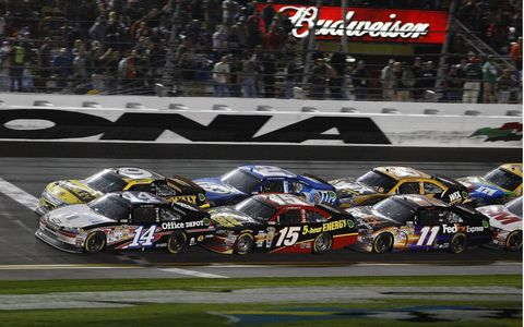 Drivers get ready for a restart Saturday night in Daytona during the  Bud Shootout.