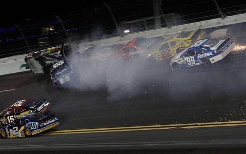 Jeff Gordon's No. 24 car gets knocked on its side during one of Saturday night's many crashes at Daytona.
