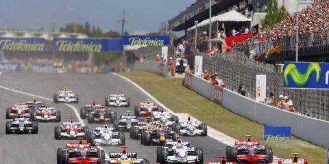Kimi Raikkonen, Ferrari F2008 and Felipe Massa, Ferrari F2008 lead the field at the start of the race.