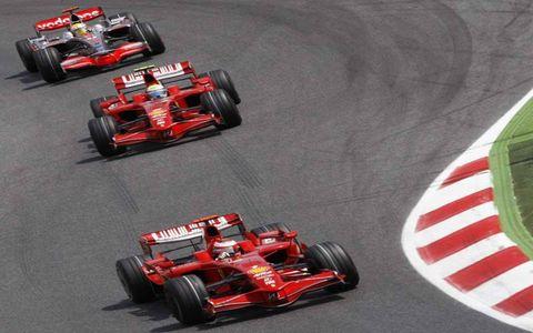 Kimi Raikkonen, Ferrari F2008, 1st position, leads Felipe Massa, Ferrari F2008, 2nd position, and Lewis Hamilton, McLaren MP4-23 Mercedes, 3rd position.