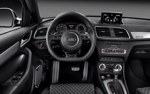 Interior details on the Audi RS Q3 include gray-colored gauge faces, leather-trimmed sport seats and a flat-bottom steering wheel.