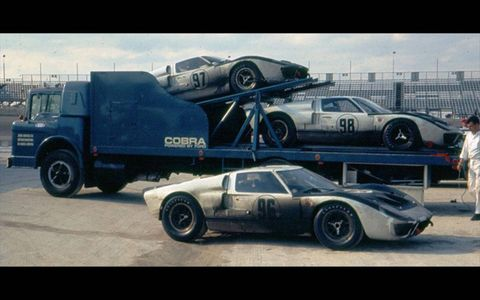 A rare color photograph shows a trio of GT40 Mark IIs at Daytona. P/1011 is wearing the no. 97 livery.