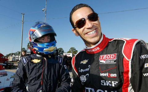 A.J. Allmendinger, left, and Helio Castroneves laugh it up at Sebring on Tuesday.