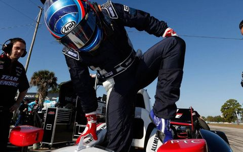 A.J. Allmendinger climbs into his office on Tuesday for an IndyCar test at Sebring, Fla.