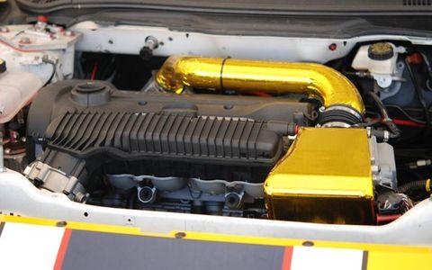 Motor vehicle, Yellow, Engine, Automotive engine part, Automotive air manifold, Nut, Fuel line, Automotive super charger part, Hood, Screw,