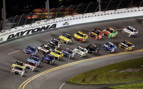 Dale Earnhardt Jr. takes the lead during the first of two 150-mile qualifying races on Thursday at Daytona International Speedway.