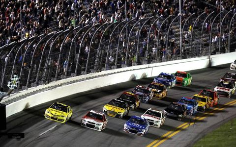 Matt Kenseth takes the checkered flag to close out the first of two 150-mile qualifying races at Daytona International Speedway on Thursday night.