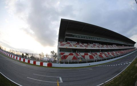 The grandstands at Barcelona were empty before testing.Photo by: LAT Photographic