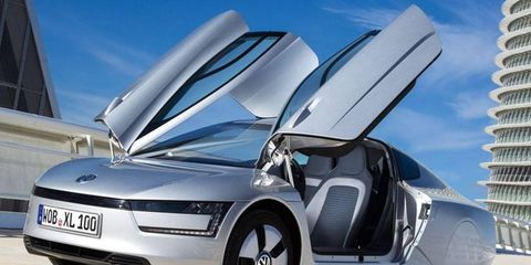 The Volkswagen XL1 diesel plug-in hybrid makes extensive use of carbon fiber and aluminum to keep its curb weight low.