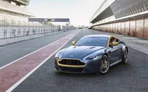 The show car is done in green and yellow, a trademark for Aston, with carbon fiber and Kevlar seats and 10-spoke alloy wheels finished in graphite.