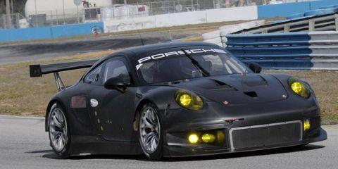 Wheel, Automotive design, Rim, Performance car, Car, Fender, Road surface, Sports car, Automotive tire, Asphalt,