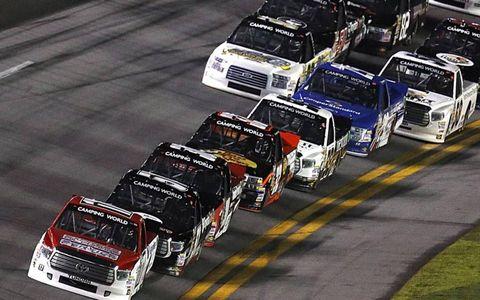 Camping World Trucks Series trucks speed around Daytona.