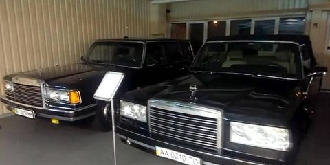 A ZiL 41047 limousine, left, sits next to a ZiL 410441 parade cabriolet, made by Zavod Imeny Likhacheva in Moscow.