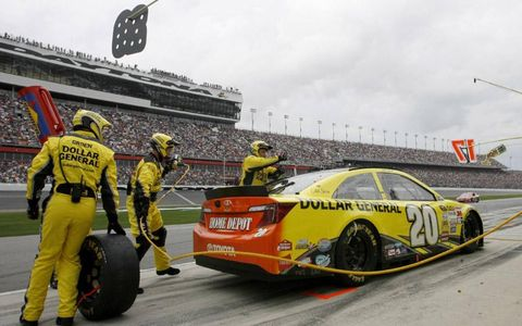 Matt Kenseth ends up turned around on pit road.