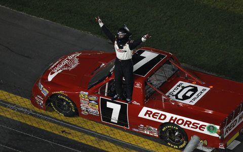 John King salutes the crowd after winning at Daytona on Friday night