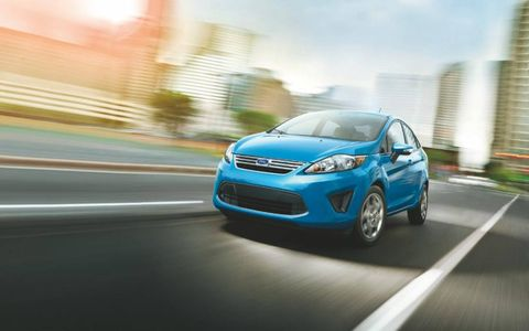 Under the hood, the 2014 Ford Fiesta SE sedan sports a 1.6-liter DOHC I4 engine.