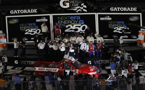 John King celebrates in victory lane after winning at Daytona on Friday night.