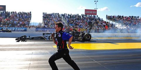 NO CHANCE// John Benshoof looks like he's racing a Top Fuel dragster at the recent NHRA in Phoenix, but in reality he was sprinting to get in front of Antron Brown's Top Fuel dragster to line him up following a burnout.