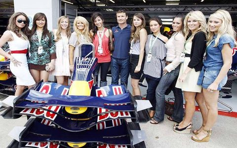 David Coulthard announced his retirement this past weekend. Here he is posing with some grid girls.