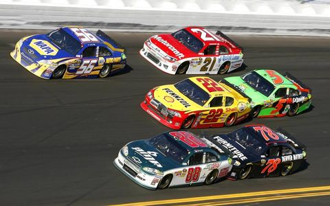 Three wide racing on the high banks of Daytona International Speedway