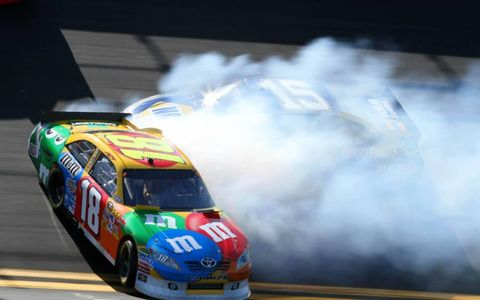 SMOKY START: Kyle Busch found himself going sideways on lap four of the 2011 Daytona 500, cloaking Michael Waltrip in tire smoke. Busch recovered from the spin with no damage, led the race three times and finished eighth.