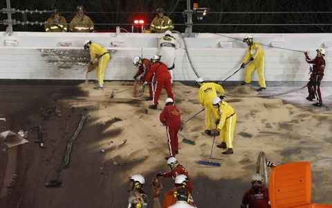 A cleanup crew went to work immediately to clean the track.