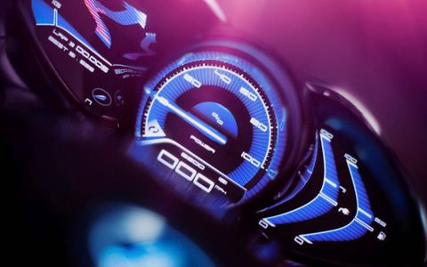 Gauge, Purple, Electric blue, Magenta, Speedometer, Measuring instrument, Symbol, Luxury vehicle, Brand, Trip computer,