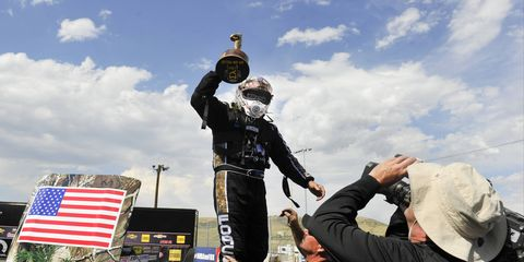 John Force celebrates his record 144th career Funny Car victory.