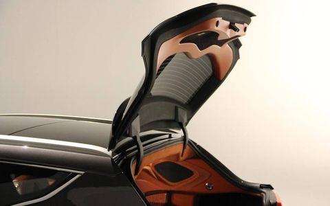 Automotive design, Fictional character, Orange, Animation, Toy, Animated cartoon, Concept car, Machine, Hood, Fiction,