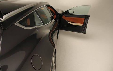 Automotive design, Vehicle door, Glass, Personal luxury car, Luxury vehicle, Windshield, Hood, Sports car, Supercar, Concept car,