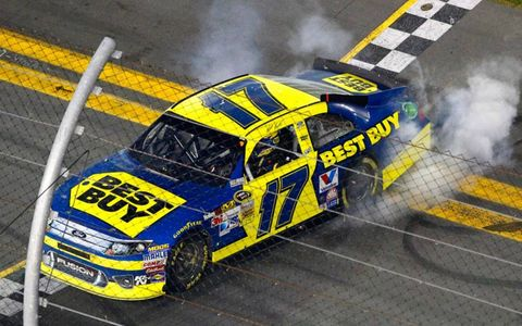 Matt Kenseth celebrates his Daytona 500 win with a burnout in front of the main grandstand.