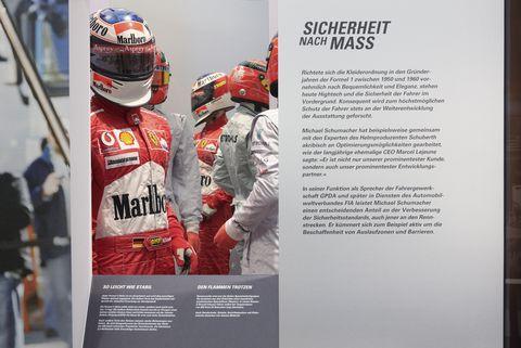Advertising, Helmet, Brand, Display advertising, Formula one, Vehicle, Motorsport,