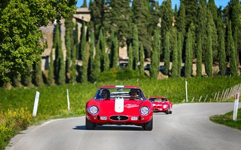 Amidst all the celebrating for Ferrari's 70th, the Ferrari 250 GTO celebrated its 55th birthday last week. Twenty of the 36 GTOs ever built gathered in Italy last week and rallied through through Tuscany, lapped Mugello, paraded around the track at Fiorano and finished up at the factory in Maranello. Bene! Bene!