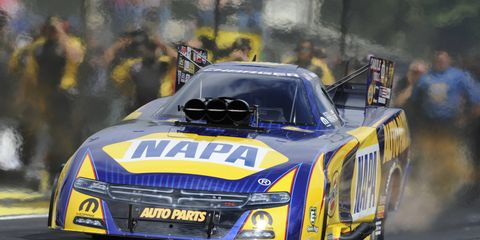 Ron Capps will race in the rain-delayed Funny Car final on Saturday.