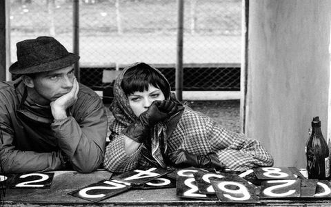 Belgian Formula One and sports-car driver Willy Mairesse waits in the pits with a companion during the 1962 Nurburgring 100 KM.