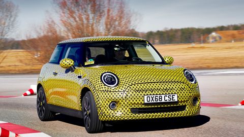 Land vehicle, Vehicle, Car, Motor vehicle, Mini, Yellow, Mini cooper, Automotive design, Subcompact car, City car,