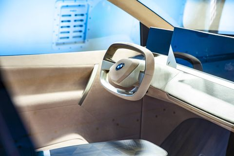 The BMW Vision iNext comes with two captains chairs and a fancy one-piece bench in the back.