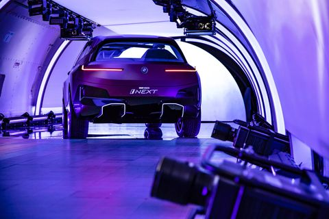 BMW revealed the Vision iNext in a plane in a hanger at JFK airport in New York.