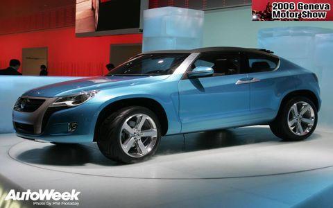 Tire, Wheel, Motor vehicle, Automotive design, Vehicle, Land vehicle, Automotive wheel system, Automotive lighting, Car, Automotive tire,