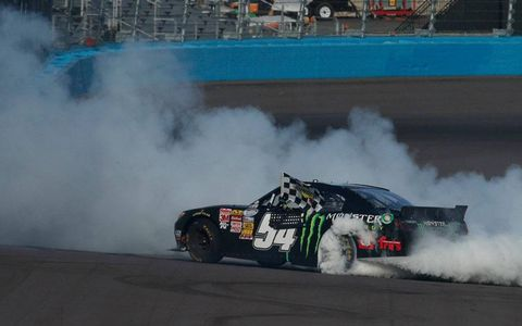 Kyle Busch celebrates his NASCAR Nationwide Series win at Phoenix on Saturday.
