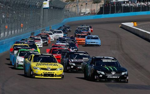 Kyle Busch leads the field at the start of the Nationwide Series race at Phoenix.
