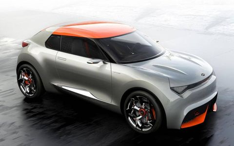 The Kia Provo uses orange to accent its gray paint.
