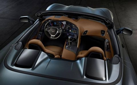 The hard cover on the 2014 Chevrolet Corvette Stingray convertible includes blacked-out panels behind the seat head rests.