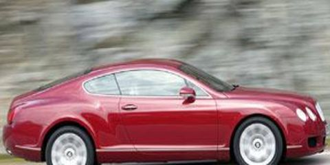 Tire, Wheel, Automotive design, Vehicle, Transport, Red, Car, Fender, Automotive tire, Automotive exterior,