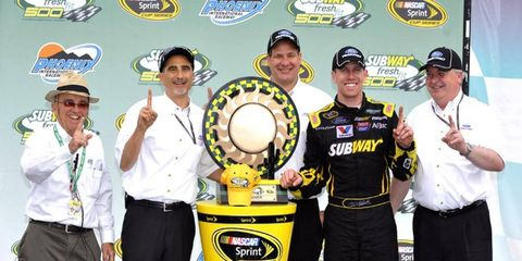 Carl Edwards celebrates his win in Victory LanePhoto by: LAT Photographic