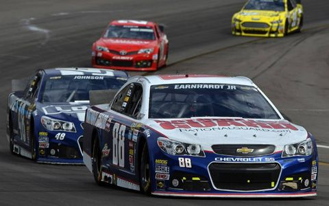 Dale Earnhardt Jr and Jimmie Johnson carsPhoto by: LAT Photographic