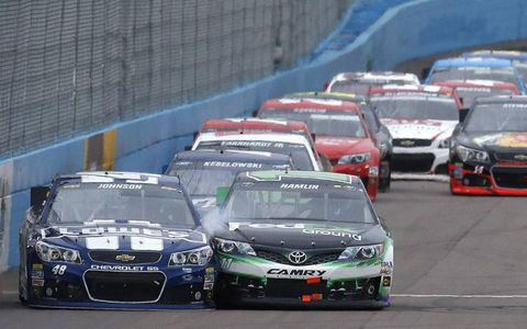 Jimmie Johnson and Denny Hamlin fight for 2nd place at the checkered flagPhoto by: LAT Photographic