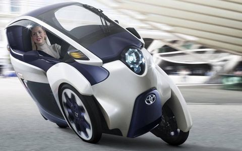 Toyota unveiled the three-wheeled, all-electric i-ROAD concept at the Geneva motor show.